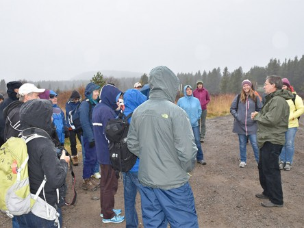 Gord Stenhouse at a field site, explaining grizzly bear research to the Inside Education group.