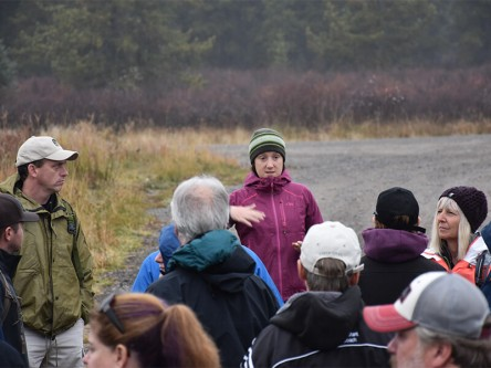 Laura Finnegan discusses Caribou Program research with the Inside Education group during the field tour.