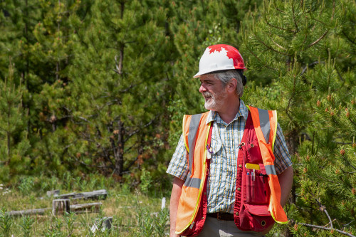 Man wearing safety gear in the woods