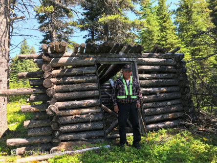 Roland Karakuntie and the trapping cabin he built many decades ago, last used in the early 1970s.