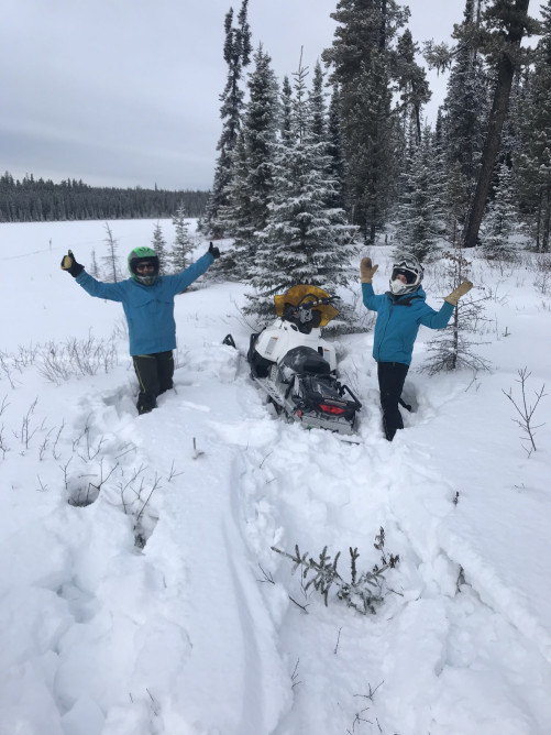 Two reseachers with their snowmobile near the Kakwa camp. Photo credit: Suzanne Stevenson