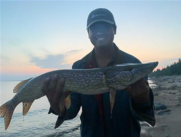 Christian holding a large pike