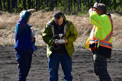 Brent Joss (center) of the NRCan Canadian Wood Fibre Centre was on hand to get some aerial UAV footage of the field tour!