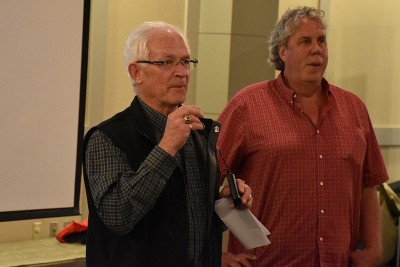 Keith McClain and Derek Sidders call the event to order on Tuesday evening.